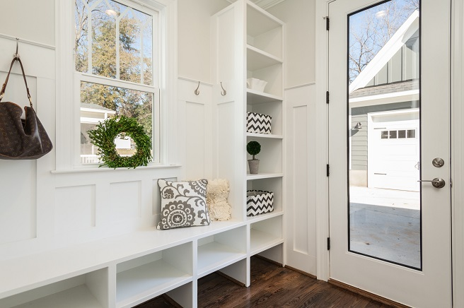 Clean white mudroom shelves and bench
